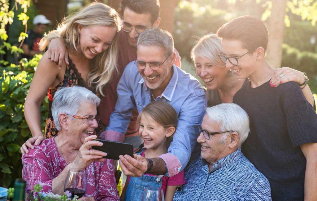 Large family enjoying day outside